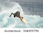 A Surfer Executes A Radical...