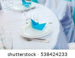 Table Setting. A Paper Boat.