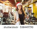 Young Woman With Red Santa Hat...
