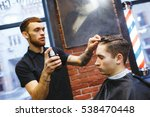 master cuts hair of men in the... | Shutterstock . vector #538470448