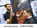 master cuts hair of men in the... | Shutterstock . vector #538470580