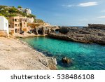 Small photo of Cala s'Almonia, beach with small fishermen houses Mallorca. Spain.