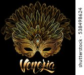 golden carnival mask with...