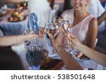 hands holding glasses and... | Shutterstock . vector #538501648