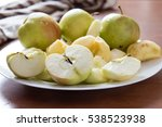 Apples Cut On A White Plate On...