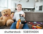 photo of boy sitting on sofa... | Shutterstock . vector #538554004