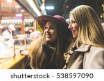 two young women buying food at...   Shutterstock . vector #538597090