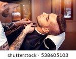 young man having beard shaven | Shutterstock . vector #538605103