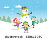 happy kids playing with snowman | Shutterstock . vector #538619050