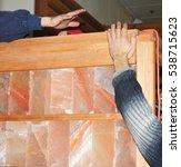 installing dry salt sauna with... | Shutterstock . vector #538715623