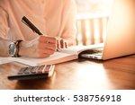 close up women hand on writing...   Shutterstock . vector #538756918