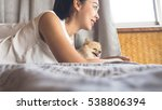 asian woman relax on bed with... | Shutterstock . vector #538806394