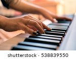 woman's hands playing the piano | Shutterstock . vector #538839550