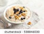 oatmeal porridge with walnuts ... | Shutterstock . vector #538846030