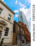Small photo of London, UK - June 15, 2016: historic building and skyscraper in Aldgate. Its a city ward of London, that is dominated by the insurance industry and encloses several prominent buildings