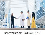 Small photo of Business man from arab muslim country shake their hands with business woman after agreed an agreement in front of office building in business area. Business concept