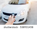 hand holding car's remote... | Shutterstock . vector #538931458