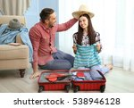 happy couple packing suitcase... | Shutterstock . vector #538946128