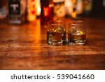 whiskey drinks on  wood in bar | Shutterstock . vector #539041660