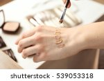 female visagiste applying... | Shutterstock . vector #539053318