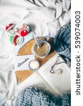 cupcakes  book and coffee in bed | Shutterstock . vector #539074003