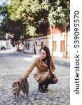 Cute Girl Stroking A Cat On The ...