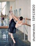 Ballet Dancers Warming In A...