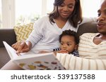 parents and son reading book on ... | Shutterstock . vector #539137588