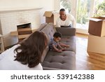 parents carry son on sofa into... | Shutterstock . vector #539142388