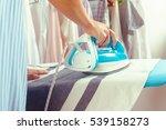 closeup of woman ironing... | Shutterstock . vector #539158273