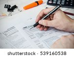 man filling us tax form. tax... | Shutterstock . vector #539160538