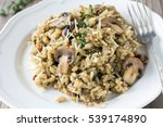 mushroom risotto on white plate ... | Shutterstock . vector #539174890