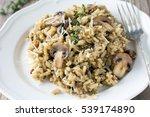 mushroom risotto on white plate ... | Shutterstock . vector #539174890