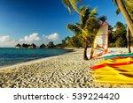 colorful kayaks rest on...   Shutterstock . vector #539224420