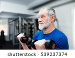 senior man in gym working out... | Shutterstock . vector #539237374