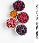 organic frozen berries in bowls ... | Shutterstock . vector #539248723