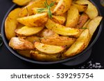 ruddy baked potato wedges with... | Shutterstock . vector #539295754