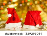 two santa claus hats on a... | Shutterstock . vector #539299054