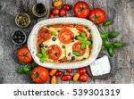 feta baked with tomatoes. greek ... | Shutterstock . vector #539301319