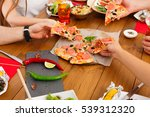 people eat pizza together at... | Shutterstock . vector #539312320