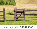 A Wooden Gate Opening Onto A...