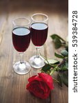 rose and two glasses of wine on ... | Shutterstock . vector #539384728