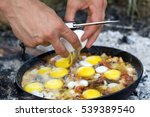 fried eggs. cooking on the fire.... | Shutterstock . vector #539389540