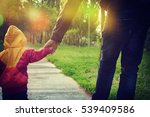 a parent holds the hand of a... | Shutterstock . vector #539409586