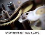 Cogs and wheels from the inside of an clock. Macro - low DOF. - stock photo