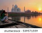 Woman Watching Sunset Over Taj...