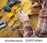 the carpenter works with wood... | Shutterstock . vector #539574964