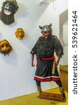 Small photo of AMBALANGODA, SRI LANKA - DECEMBER 5, 2016: The mannequin in costume and mask for the Devil Dance in mask museum, on December 5 in Ambalangoda.