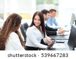 office workers with a tablet in ... | Shutterstock . vector #539667283