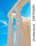 Small photo of Doric Columns on the top of Acropolis of Athens, Greece.
